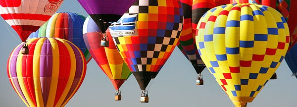 landscape of floating hot air balloons