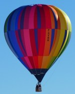 rainbow colored hot air balloon floating in the sky picture